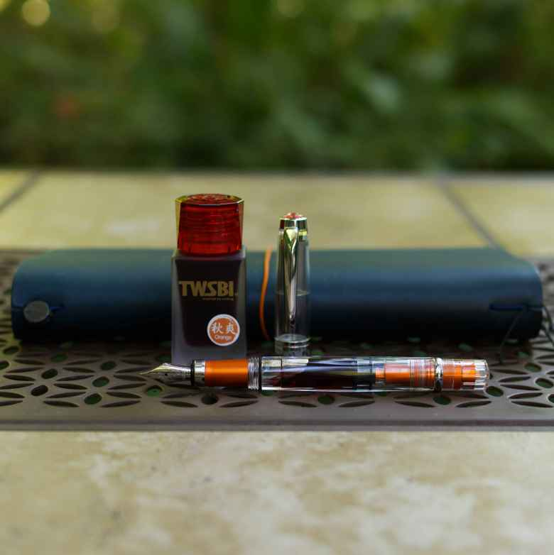 Orange TWSBI Diamond 580AL IM filled with TWSBI 1791 Orange