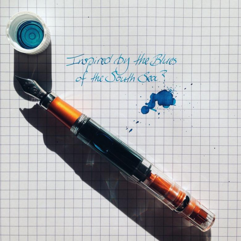 Orange TWSBI Diamond 580AL (IM) filled with Waterman Inspired Blue