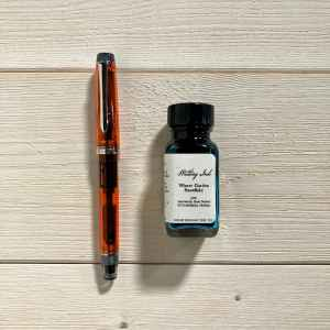Orange Pilot Custom Heritage Fine filled with Birmingham Winter Garden Snowflake